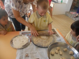 Having a go at rolling the chapati dough