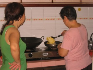 Aunty Goh expertly cooks an egg as the children 'oohed' and 'aahed' in amazement.