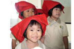 Little samsui women in their red headgears,  smiling ever so sweetly!