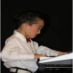Matthias concentrating hard on the keyboard as he plays a melodious tune to the audience.