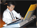 """Matthias concentrates hard at playing his  rhythmic jazz version of """"Rockets"""" on the electronic keyboard."""