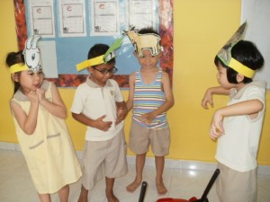 The Nursery 2 children role play a scene from the story 'The Three Billy Goats' Gruff'.