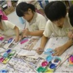 The children making colourful prints on cards, using Linoleum pieces.