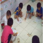 """Activity 1:  """"Let's work together. Do you know how many counters to put on the squares?"""""""